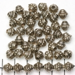 konisch versierd met rondjes en streepjes 8 mm - zilver