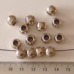 8 mm rond met 5 mm gat - zilver