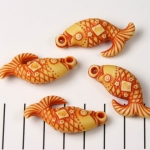 fish with Chinese symbols - orange brown