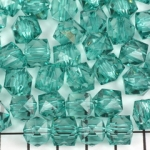 acrylic faceted cube - turquoise green