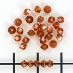 swarovski xilion bicone 3 mm - crystal copper