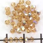 swarovski facet 3 mm - light colorado topaz ab