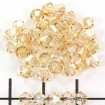swarovski xilion bicone 4 mm - crystal golden shadow