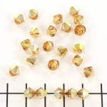 swarovski xilion bicone 6 mm - crystal metallic sunshine