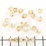 swarovski xilion bicone 6 mm - crystal golden shadow