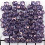 Czech faceted round 6 mm - transparant with purple marble